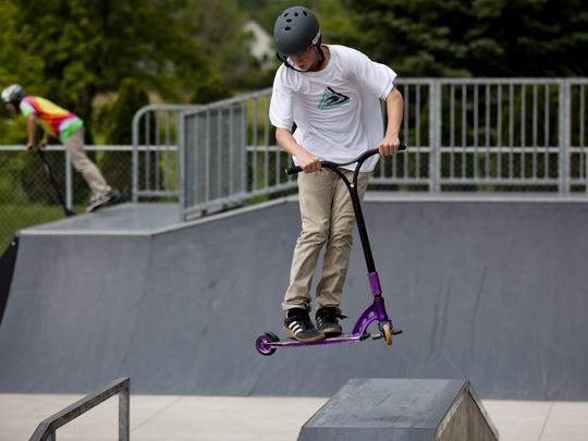 Kyle Schoof, of Richmond, maneuvers his scooter during the Summer Jam competition at the St. Clair Skate Park. The Fall Grind is Saturday at the park.