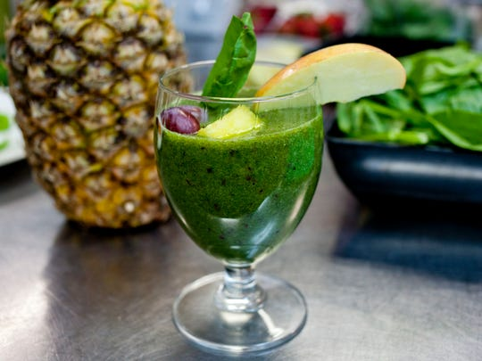 "Kokenyesdi's ""Shrek Juice"" is a healthy smoothie containing bananas, apples, grapes, pineapple, spinach, kale, and more."
