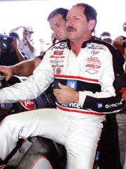 Dale Earnhardt winces in pain as he climbs out of his car after a record-setting lap to win the pole for the 1996 Bud at The Glen at Watkins Glen International.