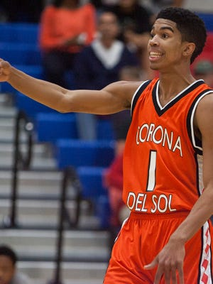 Tyrell Henderson (1) calls out a play to the Corona del Sol Aztecs during their game against the Mustangs at North High School in Phoenix on Dec. 5, 2014.