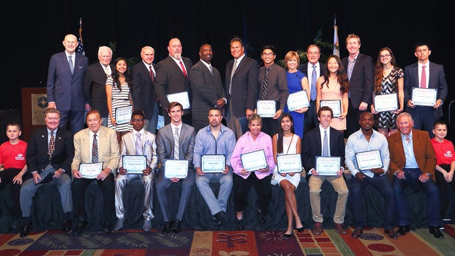 Sports legends and top local high school athletes gathered on stage after being honored.
