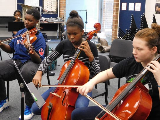 Fairview orchestra students concentrate on the music.