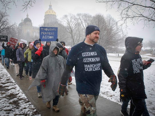 Thousands marched for tougher gun legislation during