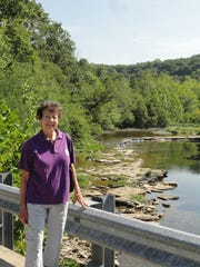 Nancy Purdy, who tells the Grant stone legend, at White Oak Creek, the source of the stone.