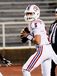 Evangel quarterback Blake Shapen looks for an open receiver during their game with Captain Shreve earlier this year at Lee Hedges Stadium.