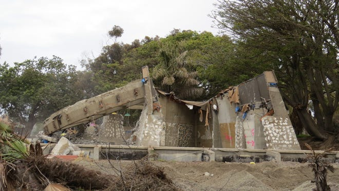 Demolition of the former Chart House restaurant in Ventura on Thursday revealed the structure's concrete walls and the ring, left, that helped form its semi-circular shape. The building had been vacant since the September 2015 closure of Joe's Crab Shack.