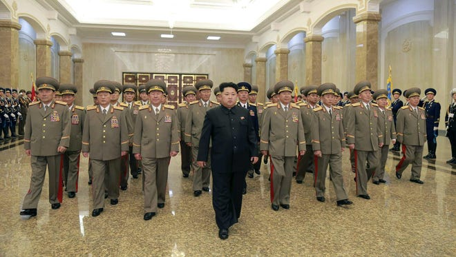 A file photo released by the Rodong Sinmun, the newspaper of the ruling North Korean Workers Party, shows North Korean leader Kim Jong Un, center, arriving at the Kumsusan Palace of the Sun in Pyongyang, North Korea in April.