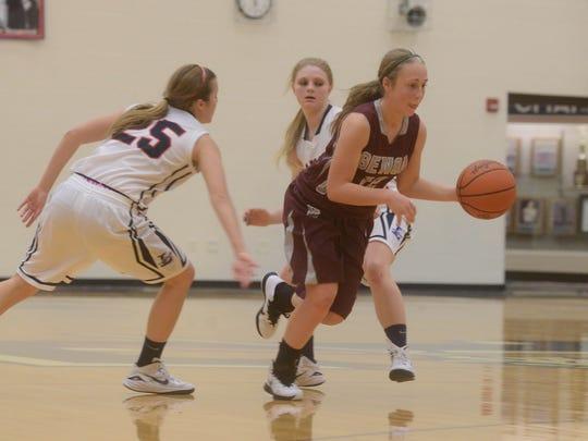 Genoa's Emily Edwards slips through the Lakota defense during a basketball game on Monday, Jan 12, 2015.