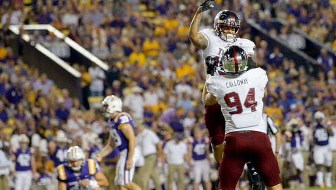 Troy wide receiver Damion Willis (15) and defensive end Seth Calloway (94) celebrate a missed field goal by LSU place kicker Jack Gonsoulin (39) in the first half of an NCAA college football game in Baton Rouge, La., Saturday, Sept. 30, 2017. (AP Photo/Matthew Hinton)