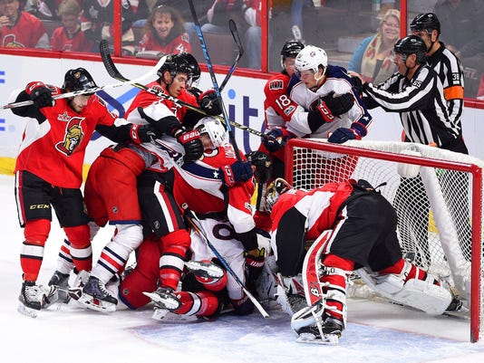 Ottawa Senators players mash up with the Columbus Blue Jackets during the first period of an NHL hockey game, Saturday, March 4, 2017 in Ottawa, Ontario. (Sean Kilpatrick/The Canadian Press via AP)