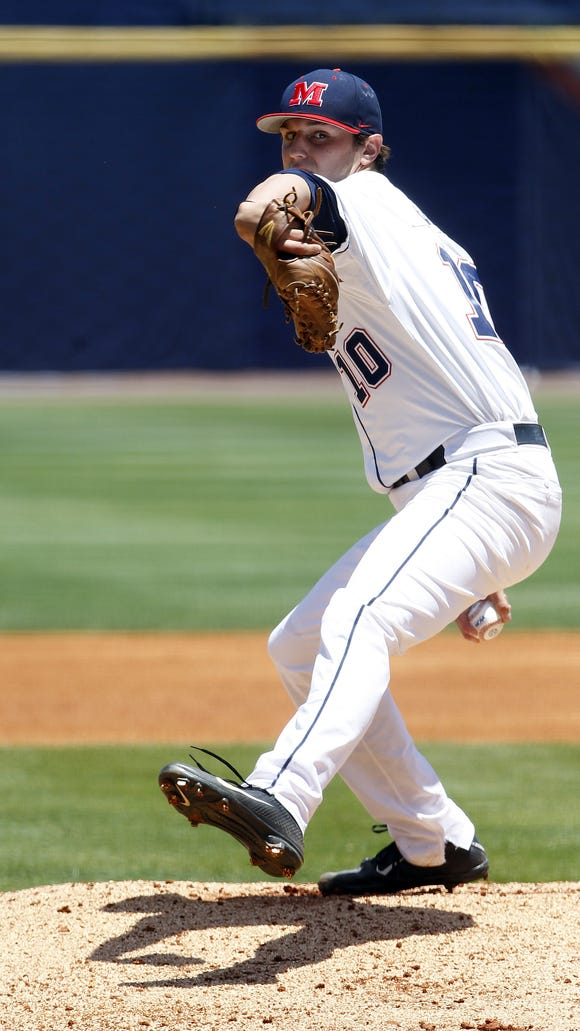Mississippi's Chris Ellis (10) pitches against Arkansas during the 1st inning at the Southeastern Conference NCAA college baseball tournament on Wednesday, May 21, 2014, in Hoover, Ala. (AP Photo/Butch Dill)