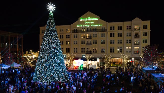 Hundreds of event-goers watch as The Liberty Center's tree is lit Nov. 18, 2016.