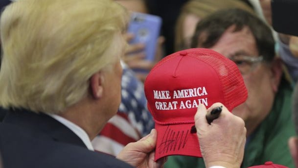 Republican presidential candidate Donald Trump signs an autograph during a rally on March 1, 2016, in Louisville, Ky.