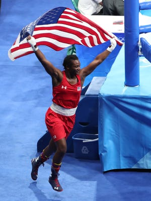 Aug 21, 2016; Rio de Janeiro, Brazil; Claressa Shields (USA) celebrates after defeating Nouchka Fontijn (NED) in the women's middleweight final bout during the Rio 2016 Summer Olympic Games at Riocentro - Pavilion 6.