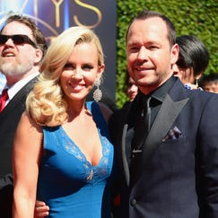 LOS ANGELES, CA - AUGUST 16: Actors Jenny McCarthy (L) and Donnie Wahlberg attend the 2014 Creative Arts Emmy Awards at Nokia Theatre L.A. Live on August 16, 2014 in Los Angeles, California.  (Photo by Frazer Harrison/Getty Images)