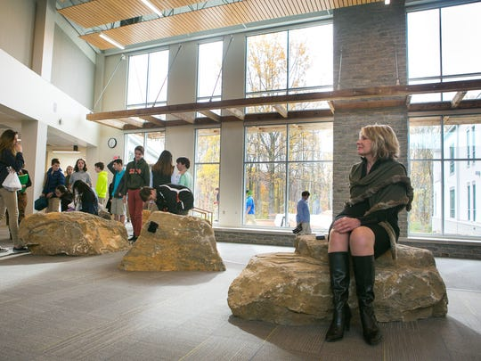 "The Pilot School director, Kathleen Craven, sits in the lobby area of the school that outlooks  the outdoor classroom. ""We are becoming almost a nature school, where nature is going to be part of nearly every subject we teach,"" Craven said."