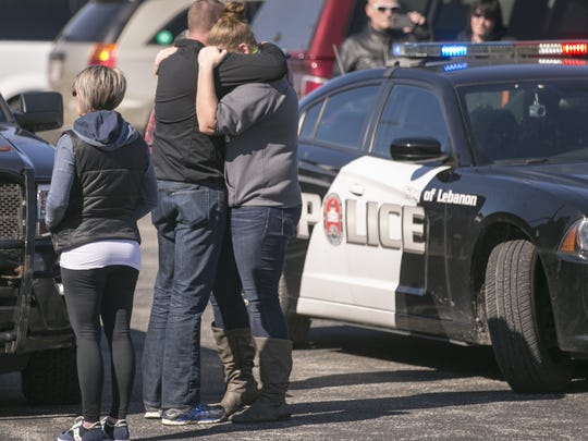 Hugs during a makeshift memorial outside the Boone County Sheriff's Office and Jail, home office of Deputy Jacob Pickett, Lebanon, Saturday, March 3, 2018. The deputy was fatally shot a day earlier while helping local police serve a warrant.
