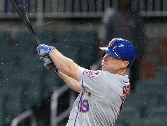 New York Mets' Jay Bruce (19) follows through with two-run home run in the fourth inning of a baseball game against the Atlanta Braves, Thursday, May 4, 2017, in Atlanta. (AP Photo/John Bazemore)