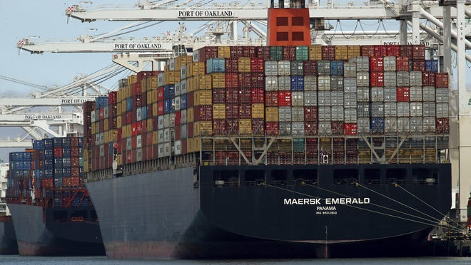 In this Thursday, July 12, 2018, file photo, the container ship Maersk Emerald is unloaded at the Port of Oakland, Calif. A U.S. government report ahead of a meeting between Presidents Donald Trump and Xi Jinping accuses China of stepping up hacking aimed at stealing American technology as a tariff dispute escalated.