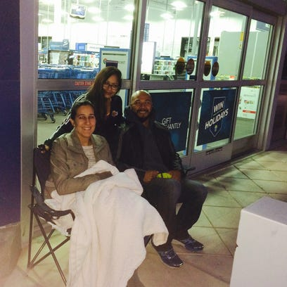 Melissa and Omar Castillo, seated, of Glendale and