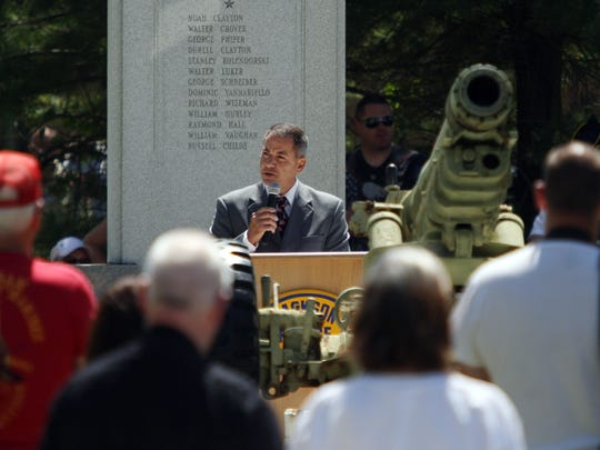Jackson Township Mayor Michael Reina speaks during Memorial Day services Monday, May 27, 2013 at the Jackson Township Veterans Memorial.  Jody Somers / For The Asbury Park Press