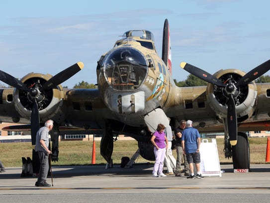 Visitors look over the B-17 Flying Fortress on display