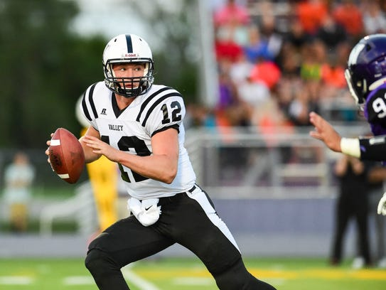 Valley quarterback Rocky Lombardi (12) scrambles to