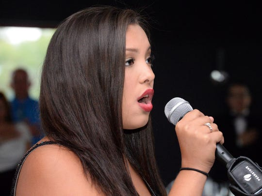 Alyssa Lopez sings the national anthem during the Puerto