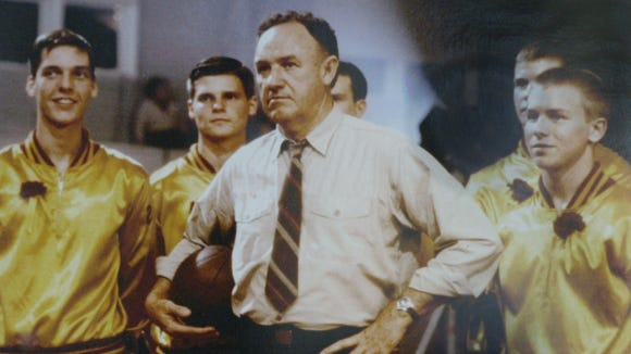 "Gene Hackman with his players during the filming of the movie ""Hoosiers."" The movie certainly captures the state's obsession with basketball. The movie was shot inside the Hoosier Gym in Knightstown. The movie detailed the fictional team Hickory and their march to the state title, based on the true story of Milan High School and their title in the 1950's."