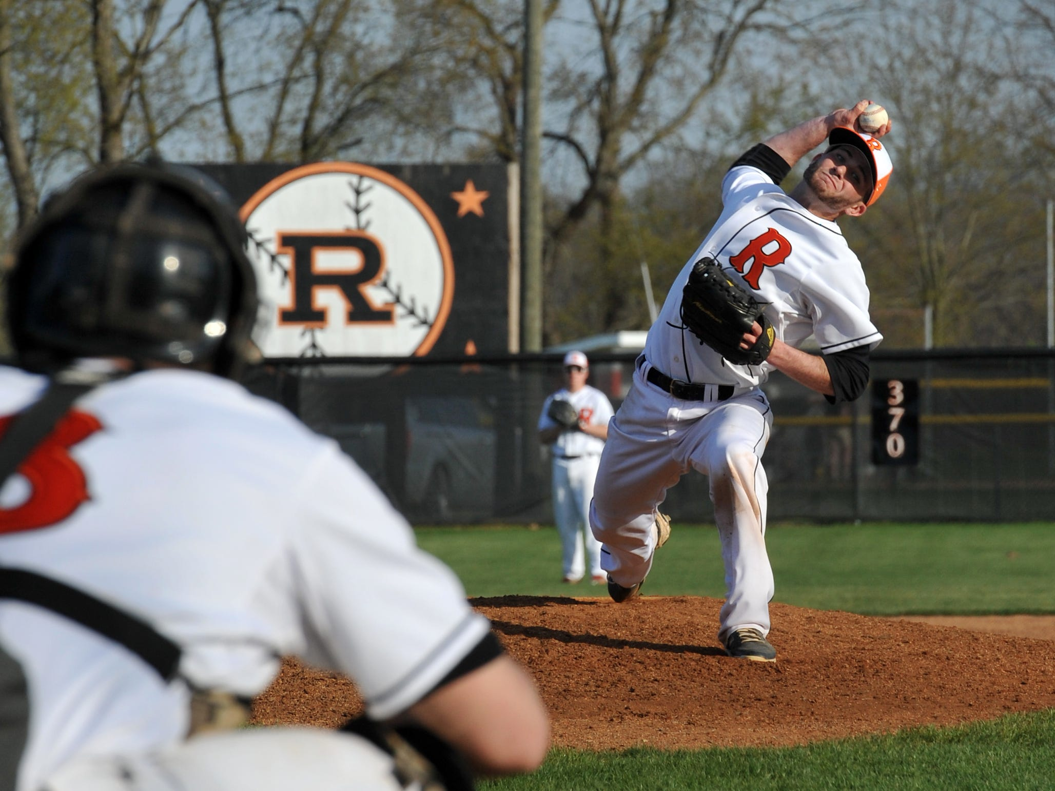 Ridgewood senior pitcher Caleb Tingle throws in one of the final pitches of the top of the seventh inning against TCC Tuesday evening.