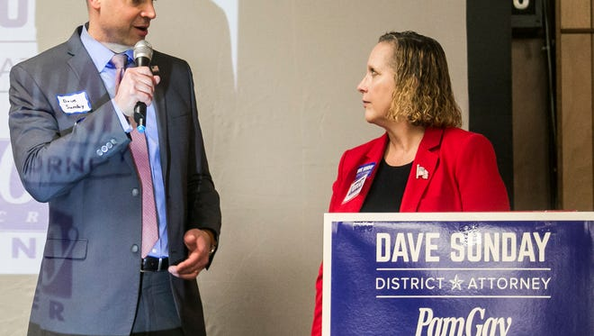 District Attorney candidate and current Chief Deputy Prosecutor Dave Sunday, left,  talks about York County Coroner Pam Gay, during their campaign kick-off Friday, Feb. 10, 2017, at the Alert Fire Company, in Emigsville.  Gay will be seeking re-election for a second term as coroner. Amanda J. Cain photo