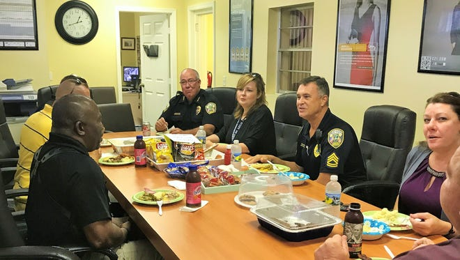 Local first responders enjoy a meal at Century 21 All Professional in Port St. Lucie.