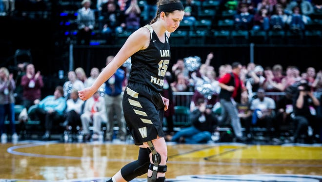 Winchester's Shelby Miller played three weeks after tearing her ACL against Central Noble in the state championship game at Banker's Life Fieldhouse Saturday, Feb. 24, 2018.