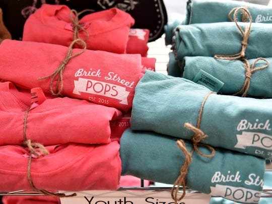 Aside from pops, candy and soda, the new Brick Street Pops at the corner of Leake and Monroe streets in Clinton carries shirts.