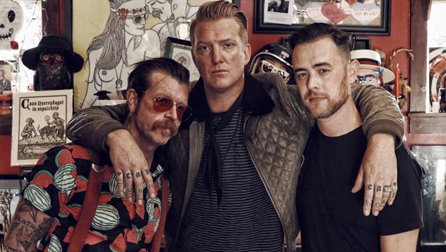 """Jesse Hughes (left) and Josh Homme (center) are featured in """"Eagles of Death Metal: Nos Amis (Our Friends),"""" directed by Colin Hanks."""