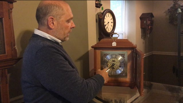 Clock repairman Steve Shroyer of Galion, shows this visitor how to turn back this clock properly for the end of Daylight Saving Time.