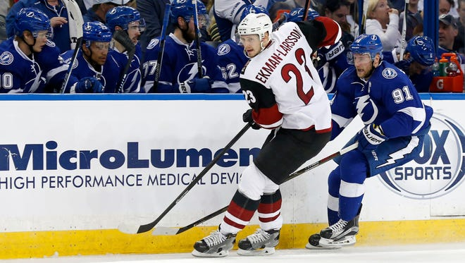Arizona Coyotes' Oliver Ekman-Larsson checks Tampa Bay Lightning's Steven Stamkos during the second period of an NHL hockey game Tuesday, Feb. 23, 2016, in Tampa, Fla.