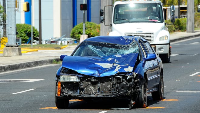 Officers with the Guam Police Department Highway Patrol Division conduct an investigation of an accident in the northbound lanes of Marine Corps Drive near the Micronesia Mall in Dededo on Thursday, June 2. A blue Honda Accord sedan and a bicycle could be seen at the scene of the investigation.