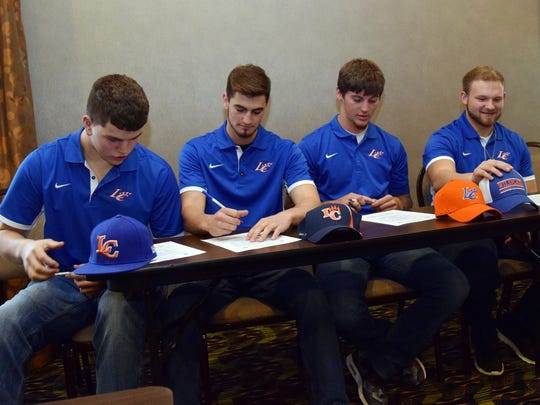 Jacob Plache (left), Kevin Comardelle, Dylan Crockett and Drew Dunn, all of Hahnville, sign letters of intent at the Holiday Inn Express on MacArthur Drive to play football at Louisiana College.