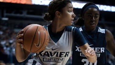 Kayla Davis (left) and teammate Raeshaun Gaffney scrimmaged at this year's Musketeer Madness at Xavier. The Musketeers host UC in the Skyline Chili Crosstown Shootout at 5 p.m. Sunday.