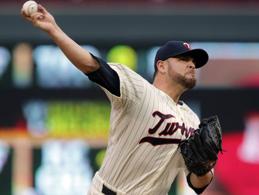 Minnesota Twins pitcher Ricky Nolasco throws against the Cleveland Indians in the first inning of a baseball game, Wednesday, Aug. 20, 2014, in Minneapolis. (AP Photo/Jim Mone)