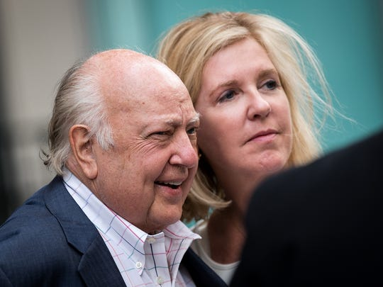 Fox News chairman Roger Ailes walks with his wife Elizabeth
