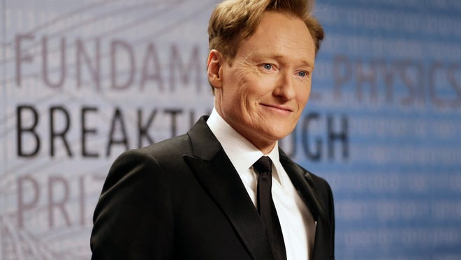 FILE - In this Dec. 12, 2013, file photo, talk show host Conan O'Brien arrives for the Breakthrough Prize in Life Sciences awards in Moffett Field, Calif.  The American late-night talk show ?Conan? has racked up more than 3 million hits since its debut on an online video site in China.  The comedy show hosted by Conan O?Brien and featuring celebrity interviews is available on the website of Sohu Video, a unit of Chinese online media group and Nasdaq-listed Sohu.com Inc.  (AP Photo/Ben Margot, File)