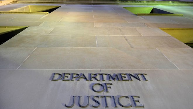 The Department of Justice headquarters building in Washington. The department's antitrust lawyers are expected to review closely the proposed Comcast-Time Warner Cable merger.