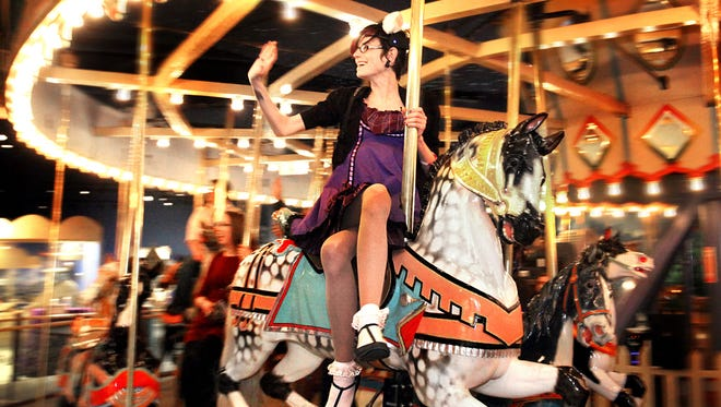 Isabele Webb enjoyed her turn on the Children's Museum's historic carousel during last year's Adult Swim event. Billed as a night of play for your inner child, this year's event will take place Saturday, Feb. 21, at 8 p.m.
