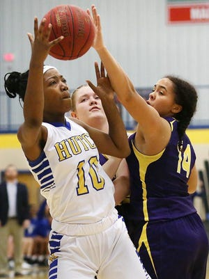 Hutchinson's Ziya Simms (10) shoots past Arkansas City's Jayden Perot (14) during their game at the Salthawk Activity Center. Simms is one of three returners for the Salthawks this season.