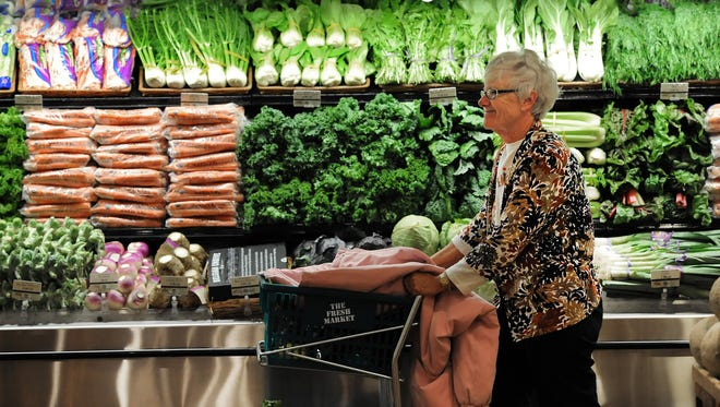 Instacart, an online grocery ordering and delivery service, is using Twitter to announce plans to launch its service in the Indianapolis area. Sharon Teipen of Fishers walks past fresh produce at the new Fresh Market store, located at 9774 E. 116th Street in Fishers i October 2013.