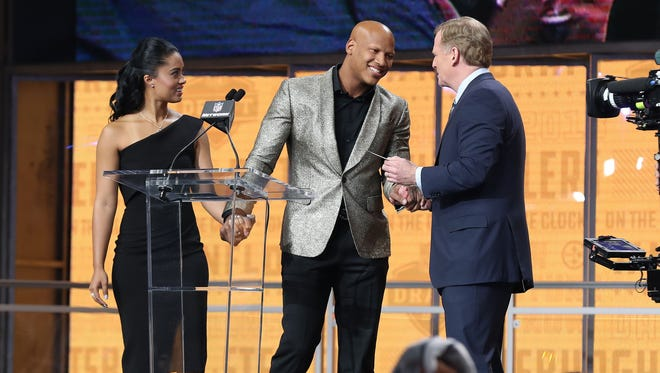 Pittsburgh Steelers linebacker Ryan Shazier walks across the stage with his fiancee Michelle Rodriguez is greeted by NFL Commissioner Roger Goodell to announce the No. 28 pick for the Pittsburgh Steelers in the first round of the 2018 NFL Draft at AT&T Stadium.