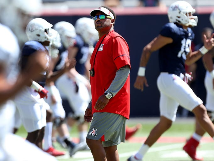 Arizona Wildcats head coach Kevin Sumlin watches his