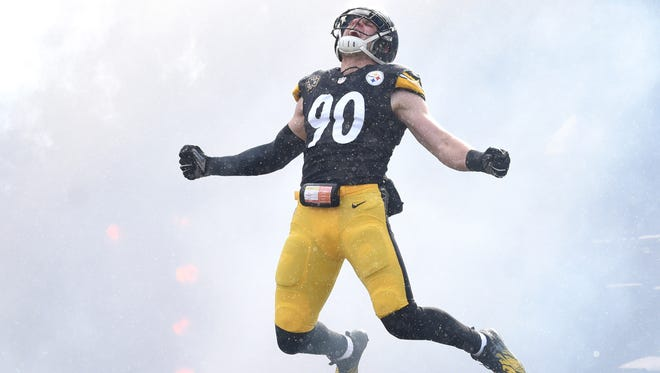 Pittsburgh Steelers linebacker T.J. Watt celebrates while being introduced before taking the field against the Cleveland Browns at Heinz Field in Pittsburgh.